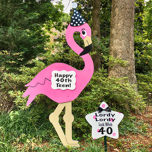 magnolia storks flamingo sign
